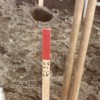 Measuring stakes were placed in areas where soil was to be extracted for testing